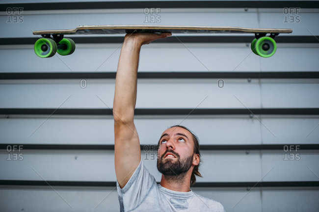 A boy launches skateboard up