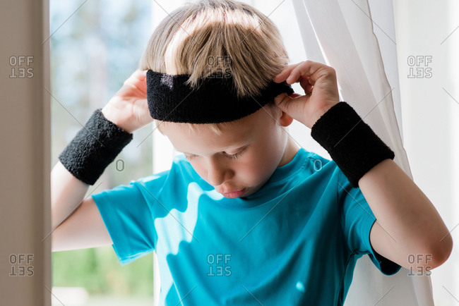 Young boy with sweat bands on ready to play sport