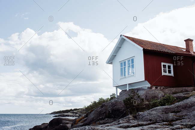Traditional swedish summer house on the coat in grisslehamn, sweden