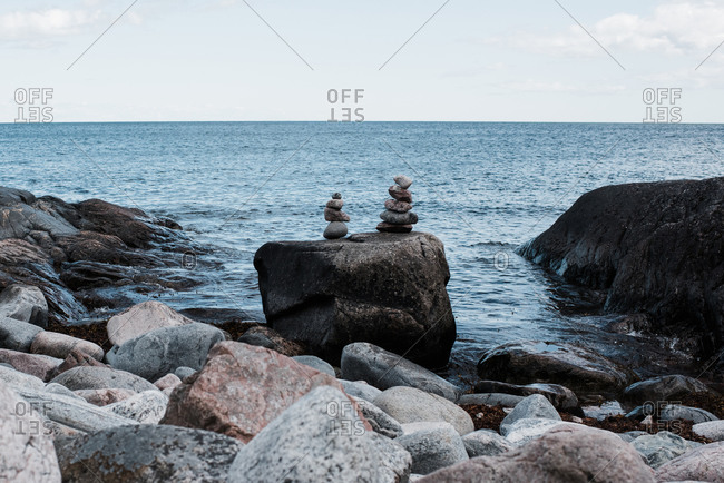 Stacked rocks by the ocean in sweden