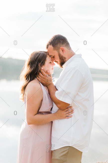An engaged couple in love during sunset