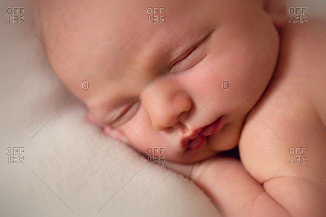 Close up of newborn baby boy sleeping
