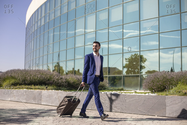 Businessman with suitcase taking a business trip