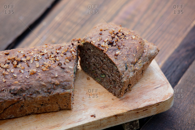 Gluten-free bread with pumpkin seeds and salt on wooden table