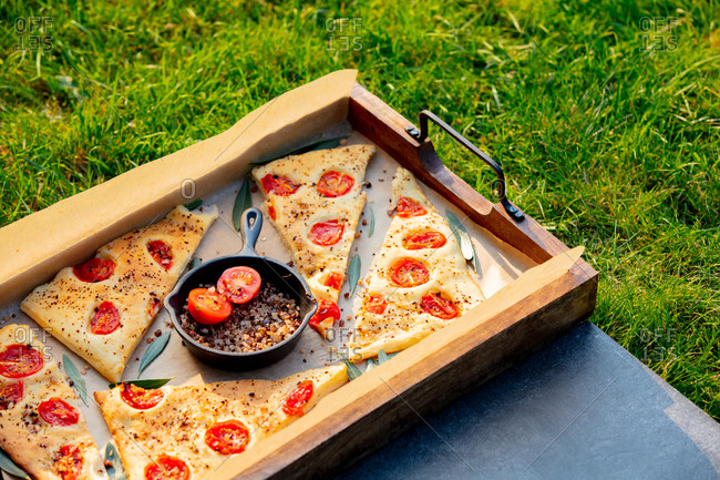 Traditional Italian focaccia bread and pan with salt served outdoors