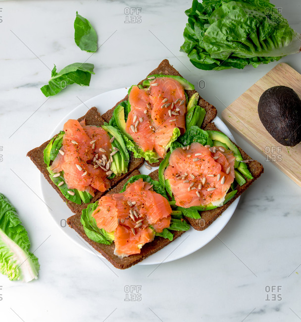 Overhead view of salmon and salad sandwich