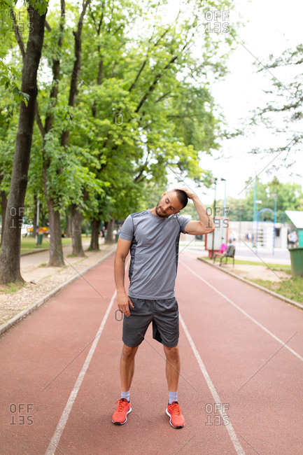 Man stretching before an outdoor workout