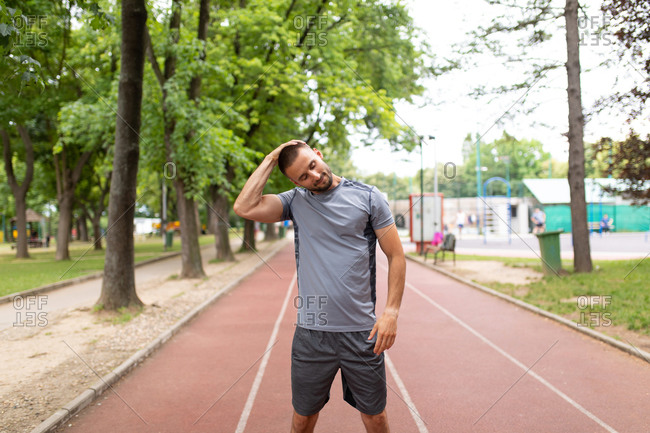 Man stretching his neck before an outdoor workout