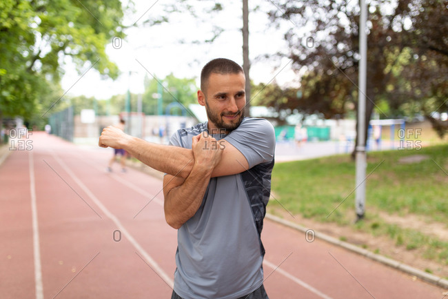 Close up of man stretching his arms before an outdoor workout