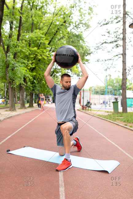 A man training with a medicine ball outdoors