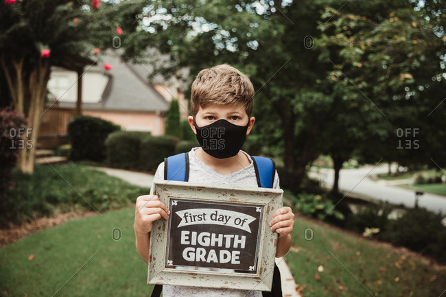 Boy wearing a mask for the first day of school
