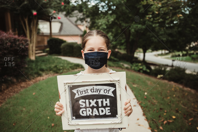 Girl wearing a mask for the first day of school