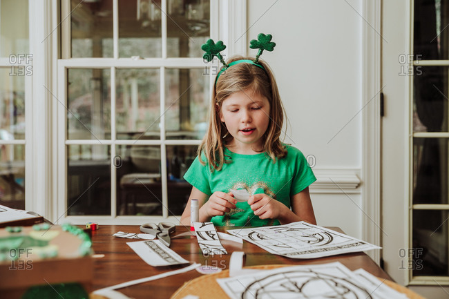 Girl working on a Saint Patrick's day craft