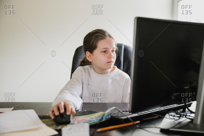 Girl doing her school work at home