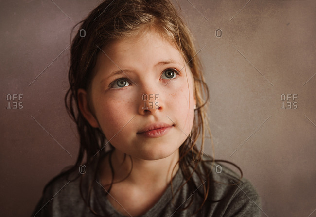 Portrait of a girl who is considering something