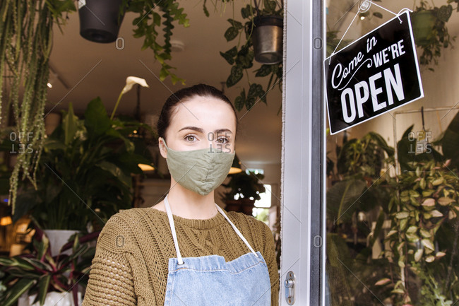 Portrait of female small business store owner wearing face mask during coronavirus pandemic