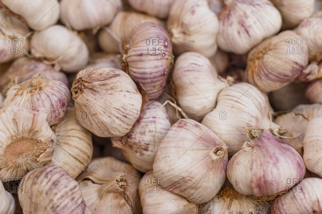 High angle of heap of raw garlic in grocery market