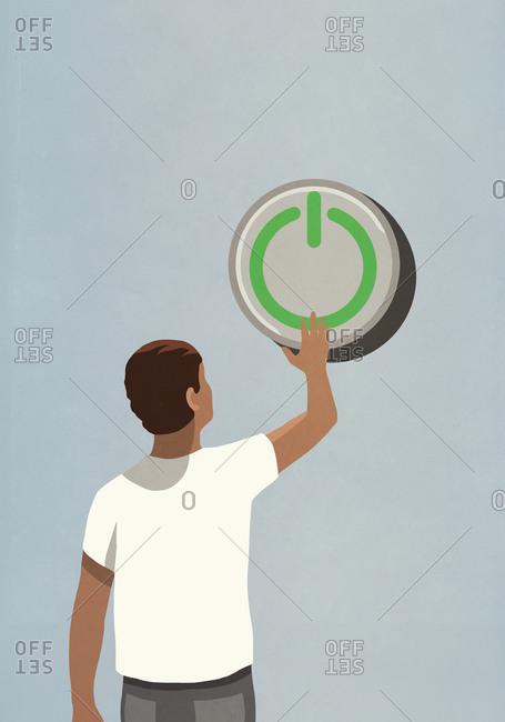 Man pushing large power on button
