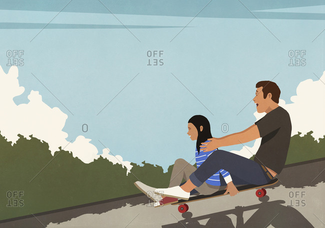 Happy father and daughter riding skateboard downhill