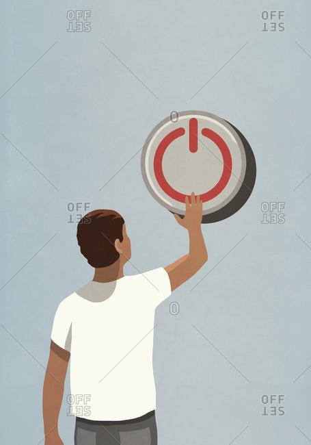 Man pushing large off button