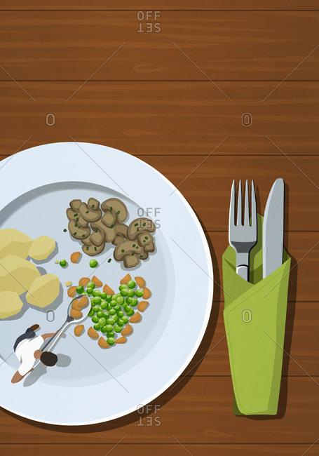 Man spooning vegetables on large plate