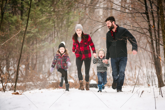 Family on walk in snow landscape