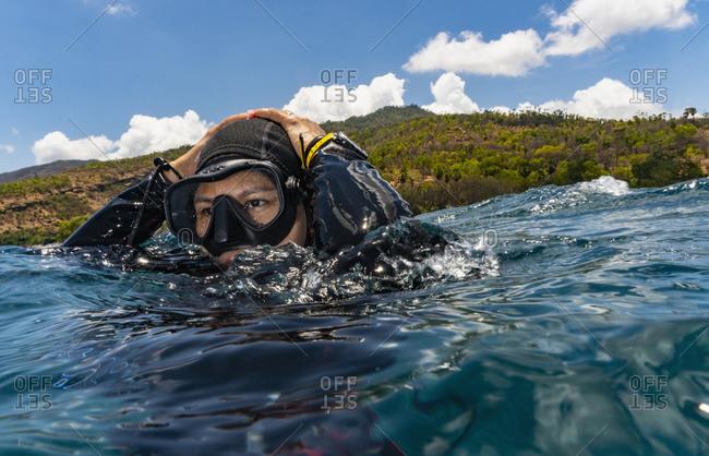Scuba diver emerges off coast, Tulamben, Bali, Indonesia