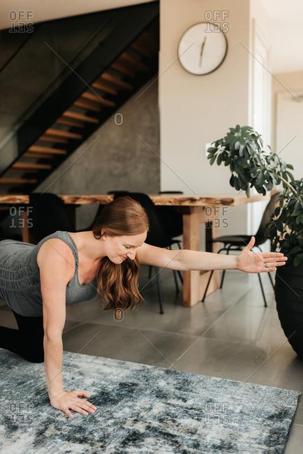 Pregnant woman doing balancing exercise