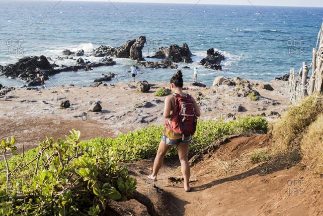 Woman visiting beach, Hookipia Beach, Maui, Hawaii