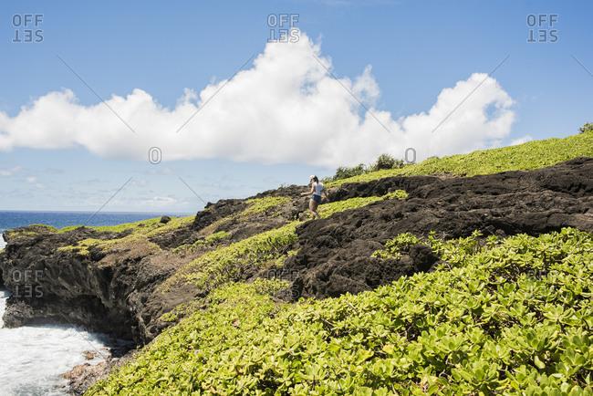 Hiker on coast, Waipipi Trail, Maui, Hawaii
