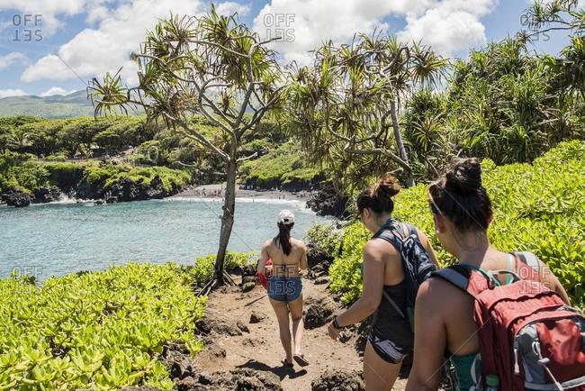 Hikers on hiking trail, Waianapanapa State Park, Maui, Hawaii