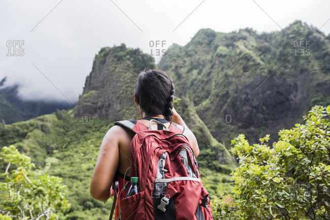 Hiker stopping to enjoy rainforest, Iao Valley, Maui, Hawaii
