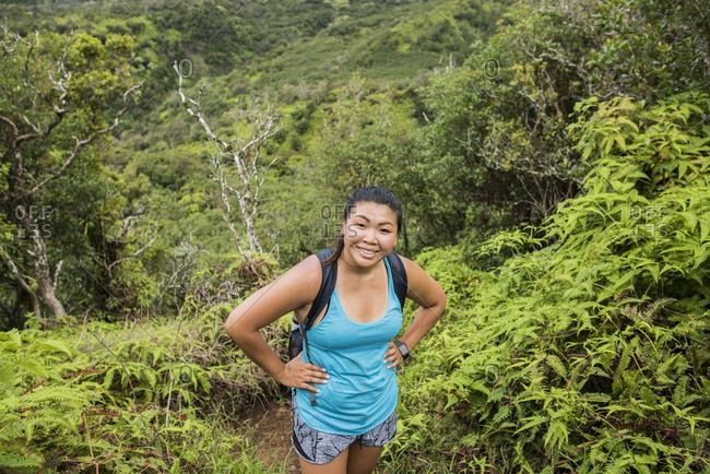 Hiker enjoying rainforest, Iao Valley, Maui, Hawaii