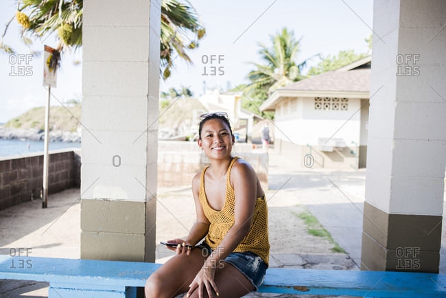 Woman sitting on bench, Hookipa Beach, Maui, Hawaii