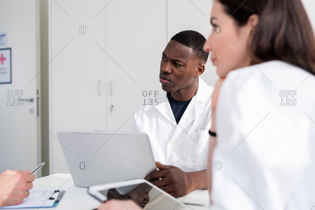 Doctors having discussion in meeting room