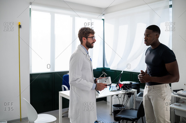 Doctor speaking with patient in consultation room