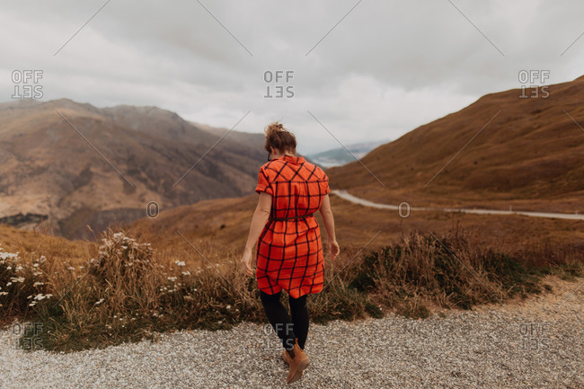 Woman enjoying scenic landscape, Queenstown, Canterbury, New Zealand