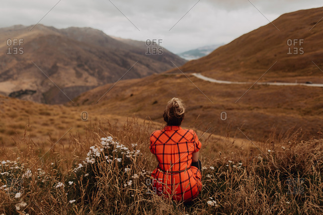 Woman enjoying view of scenic landscape, Queenstown, Canterbury, New Zealand