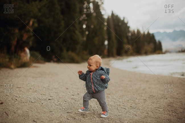 Baby walking on beach, Wanaka, Taranaki, New Zealand