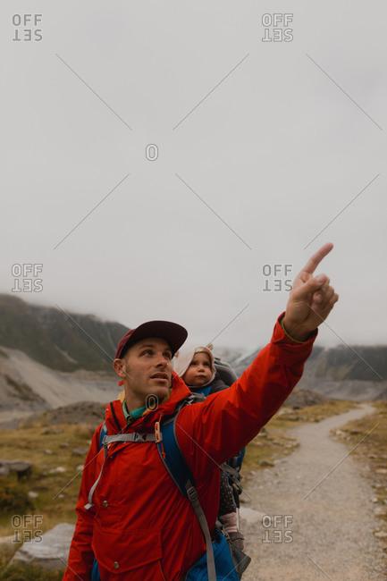Hiker and baby exploring trail, Wanaka, Taranaki, New Zealand