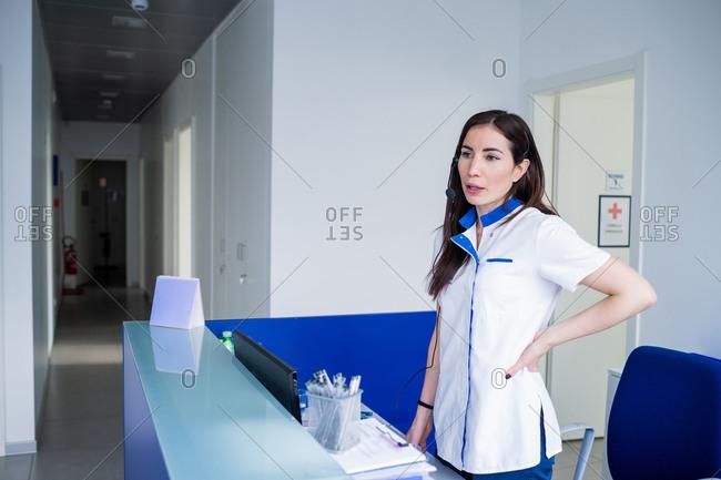 Nurse waiting at hospital reception