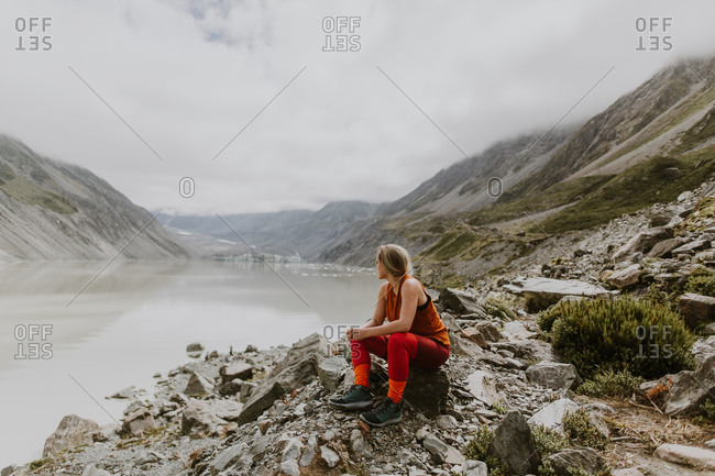 Woman enjoying scenic view by lake, Wanaka, Taranaki, New Zealand