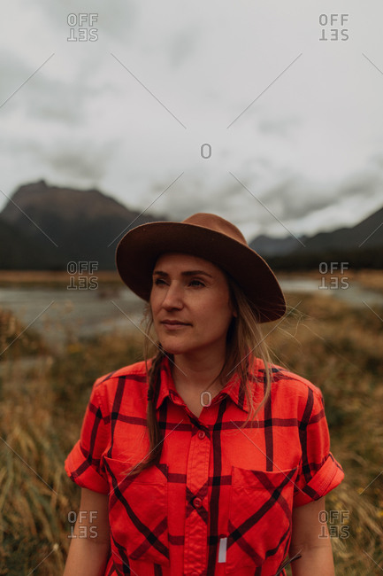 Woman exploring wilderness by lake, Queenstown, Canterbury, New Zealand