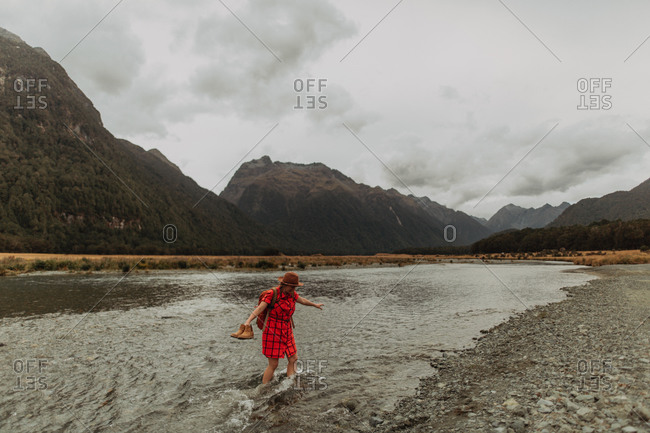 Woman exploring lake, Queenstown, Canterbury, New Zealand