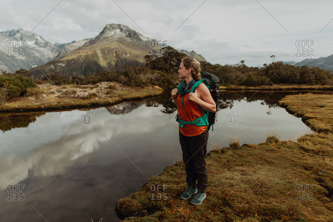 Hiker enjoying scenic lake view, Queenstown, Canterbury, New Zealand