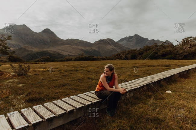 Woman relaxing on trail path, Queenstown, Canterbury, New Zealand