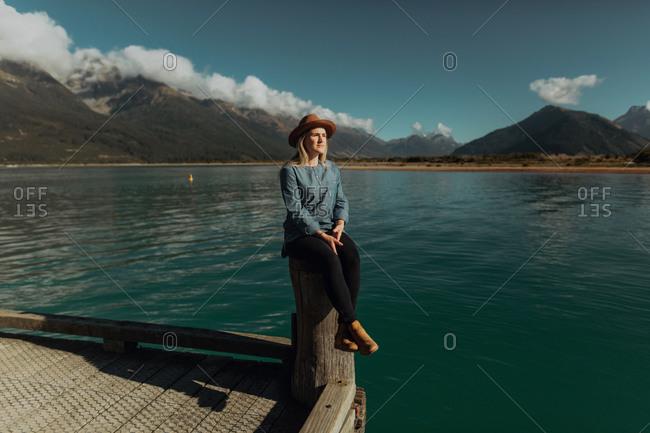 Woman enjoying scenic lake view, Queenstown, Canterbury, New Zealand