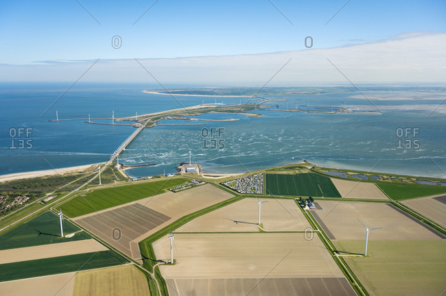 The famous Oosterscheldekering flood barrier and fields with wind turbines in the background, aerial view, Vrouwenpolder, Zeeland, Netherlands