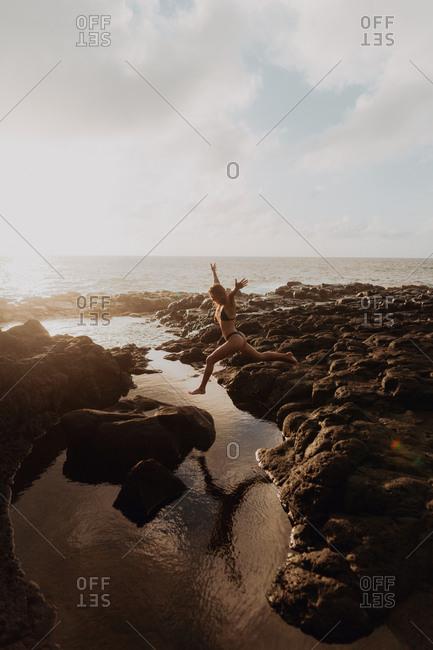 Swimmer enjoying enclosed sea pool, Princeville, Hawaii, US