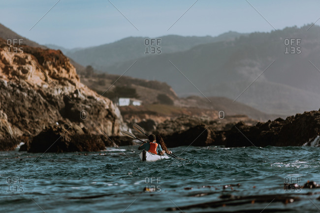 Friends kayaking in sea, Big Sur, California, United States